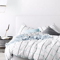 Verve, AURA's latest grid bedlinen, reborn in glacier, smoke and a beautifully soft, white cotton linen. Cotton/Linen Reverse is 100% cotton in glacier Finishe