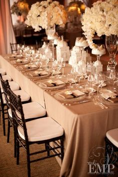 Love this look for head table. White table cloth and pink and purple flowers instead.