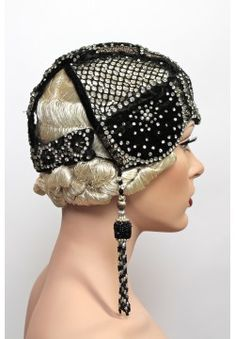 $1,600.00 - 1920's Art Deco Velvet & Rhinestone Cloche. Original beaded cloches & headdresses are nearly impossible to find today. This is an extremely rare and substantial piece that came from a single collector as part of a time capsule collection that spanned some 40 years. Black silk velvet embellished w/ neatly arranged tiny brass flatwork & prong set glittering rhinestones. Flattering flocked stone netting and elaborate beaded fringe tassels give this headpiece star quality (hva)