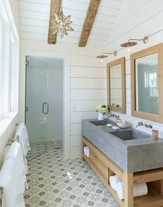 love everything here...everything. concrete sink, chunky wood sink console, gorgeous floor tile, horizontal wall paneling and the lighting!