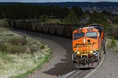 https://flic.kr/p/UXSfCg | Pocket of Sunshine | In typical fashion, a northbound BNSF coal empty led by ES44AC No. 5904 enters a pocket of sunshine as the train climbs the final portion of the grade up to the Palmer Divide at Palmer Lake, Colorado on May 17, 2017.