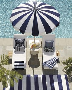 Relax poolside in our cushioned chaises with a striped beach umbrella and striped outdoor rug.