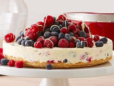 This rich and creamy cheesecake is packed full of naturally-sweet berries to create a wonderfully decadent dessert that's guaranteed to please all your dinner guests.