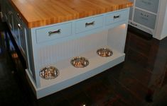 This @AK Renovations kitchen island was made with man's best friend in mind. Love those dog bone drawer handles!