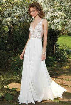 Brides: Tara Keely. Ivory chiffon A-line gown with a V-neck Venise lace bodice, illusion lace back and chapel length train.