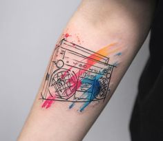 Boom box tattoo with colorful brush stroke accents