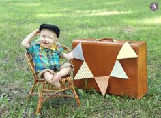 Amanda Abraham Photography: baby boy one year photo shoot in Michigan with a cake smash. Using props to enhance your children's photo session.