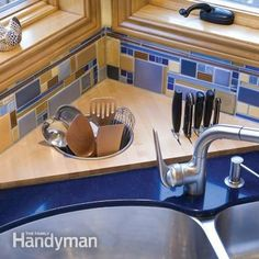 The corner counter space behind the sink was put to good use with this customized butcherblock top. The knife storage area is enclosed below the countertop to prevent accidents. A utensil storage bin was recessed into the butcher block and can hold either pot scrubbers or often-used cooking utensils.