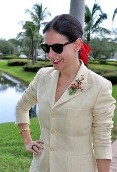 August 20, 2012  http://www.akeytothearmoire.com/post/29822895698/women-of-distinction?08e386b0  #Ralph Lauren #cream #off white #ivory #red #blazer #chiffon skirt #Jay Strongwater #Kate Spade