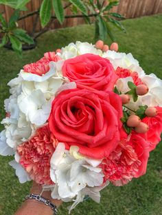 Coral roses! Gorgeous wedding bouquet!