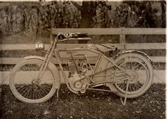 Early Harley Davidson motorcycle. .my. ..how times have changed