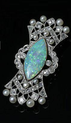 An Edwardian platinum, gold, Australian white opal, natural pearl and diamond brooch, English, circa 1910. 2.1 x 4.3cm. #Edwardian #brooch