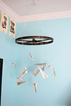 Maps as paper airplane mobile. YES! Jack's Vintage Big Boy Room My Room | Apartment Therapy