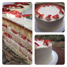 Vanilla cake with cream cheese frosting & strawberries