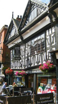"""Nantwich, Cheshire. This small market town has a large collection of historic listed buildings dating from the 14th century. After the Great Fire of Nantwich in 1583, there was extensive rebuilding, supported by Elizabeth I. Some of these buildings survive. At number 41 High Street, is a plaque on which is written: """"'GOD GRANTE OUR RYAL QUEEN IN ENGLAND LONGE TO RAIGN FOR SHE HATH PUT HER HELPING HAND TO BILD THIS TOWN AGAIN""""."""