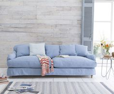 Our Achilles sofa is a deep sofa with scatter cushions for extra comfort that looks gorgeous. It is handmade in Blighty and comes in over 100 fabrics.