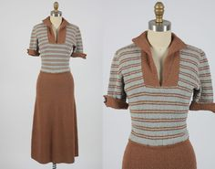 Vintage 1950s knit nubby wool sweater dress with blue and brown striped bodice with brown skirt. Short sleeves with button at cuff. Open neckline.
