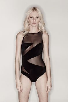 Elizabeth: This one-piece boat neck swimsuit with sheer panels in a geometric pattern is as sexy as it gets. Wear this style from the beach to the party. It can easily be worn as a body suit.