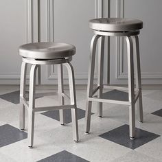 Take them for a spin. Contemporary brushed aluminum stools offer the classic 360-degree spin, with heavy-duty ball bearing action for a smooth ride.