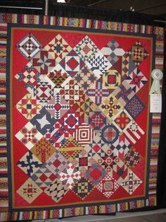 Gorgeous!!!  Quilting is big in West Virginia! Scrappy quilt by The Buckwheat Stitchers -a quilt group in West Virginia.