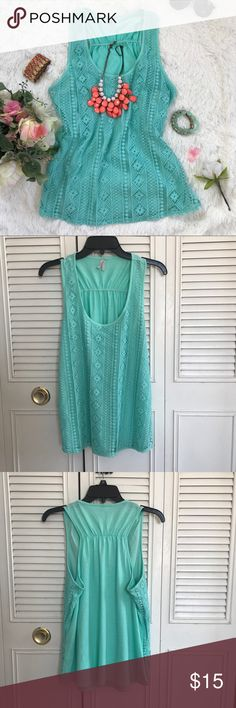 Vanity Women's turquoise lace tank top This women's tank top is come in turquoise color. It feature lace panel on the front of the shirt. Fabric are stretchy. Pre own, still in good condition.   Material: 100% Nylon base, 100% Cotton Embroidery,  Bottom: 69% Polyester, 31% Rayon Lining: 100% Polyester  Best offer accept. Vanity Tops Tank Tops