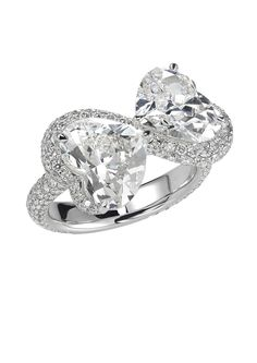 You and me, forever. This entirely unique diamond engagement ring by Chopard is a loving take on the Victorian tête à tête courting chair. Two heart-shaped diamonds weighing carats and carats are cradled in an undulating. Pear Diamond Engagement Ring, Pear Shaped Engagement Rings, Pearl And Diamond Ring, Heart Shaped Diamond, Platinum Engagement Rings, Diamond Wedding Rings, Bling Bling, Most Popular Engagement Rings, Contemporary Engagement Rings