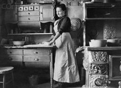 Old fashioned circa 1900 kitchen. People who lived in that era were really good at conserving resources! LOVE the cabinet she is working on. Antique Photos, Vintage Pictures, Vintage Photographs, Old Pictures, Old Photos, Old Kitchen, Vintage Kitchen, Kitchen Stuff, Vintage Cooking