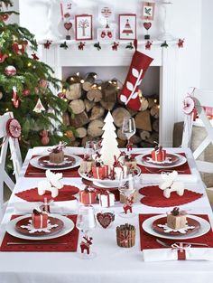 a modern red and white table setting, red and wwhite ornaments and stockings