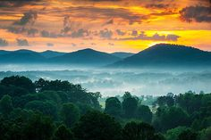 Sunset over a sea of fog and peaks of the Blue Ridge Mountains near Asheville NC.