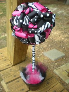 Centerpiece for zebra print party - bet I can use leopard print.