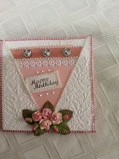 Background is sizzex embossing folder, pearl and crystal trim from 2.00 shop flowers dusty attic metal flowers are buttons