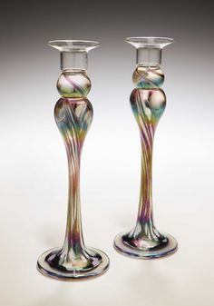 """Mardi Gras Candlestick Pair"" Art Glass Candlesticks Created by Mark Rosenbaum. wouldn't it be fun to use glass paint to create the same effect on vases, candlesticks, etc? Glass Candle Holders, Candlestick Holders, Glow Stick Wedding, Glow Sticks, Candle Sticks, Glass Candlesticks, Candleholders, Porcelain Jewelry, China Porcelain"