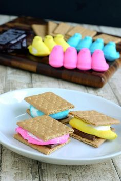 INGREDIENTS:  Colorful Peeps  Hershey's chocolate squares  graham crackers    DIRECTIONS:  1. Place graham crackers, chocolate and a peep as shown in picture. Zap in the microwave until soft. (Or place under broiler.)    2. Top with another graham cracker square.