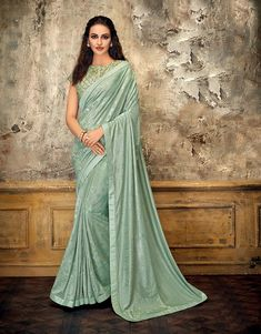 Look flawless in this beautiful aqua blue saree with tonal details and ornately embroidered blouse. Go for a stylish navy drape to look mesmerizing. Bollywood Sarees Online, Party Wear Sarees Online, Raw Silk Saree, Indian Clothes Online, Blue Saree, Designer Sarees Online, Fancy Sarees, Traditional Sarees, Saree Styles