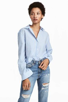 Light blue/white striped. Shirt in woven, stretch cotton fabric. Classic button placket, yoke at back with a pleat, and long sleeves with buttons at cuffs.