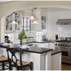 Counter and arch between kitchen and family room.  Don't want too many eat in areas.  This is one option vs banquette or island seating.
