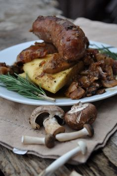 Italian sausages cooked with mushrooms and white wine on the Tripepi Family secret Polenta recipe ..... buonissimo!