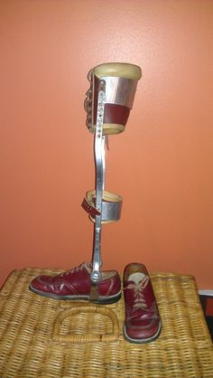This is a childs leg brace, my guess is from the 1970's. It has leather straps and stride rite shoes attached to it. This thing is creepy and cool all at the same time! It would make a great prop for a play, you could use it for a Halloween costume, you could even decorate with it if you are into that!