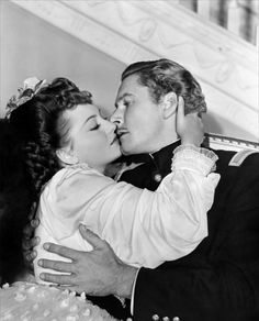 THEY DIED WITH THEIR BOOTS ON (1941) - Errol Flynn & Olivia De Havilland - Directed by Raoul Walsh - Warner Bros. - Publicity Still.