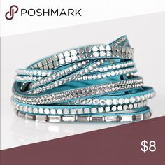 Bracelet A mishmash of smoky and white rhinestones, flat silver beads and sparkling emerald-cut gems are sprinkled along strands of blue suede for a sassy look. The elongated design allows for a trendy double wrap around the wrist. Features an adjustable snap closure. Jewelry Bracelets