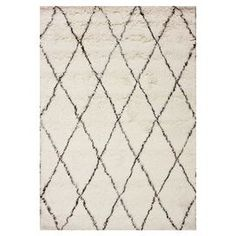 Bring a touch of texture to your master suite ensemble or living room seating group with this hand-tufted wool rug, showcasing a luxe shag design and chic trellis motif.  Product: RugConstruction Material: WoolColor: IvoryFeatures:  Hand-tufted Shag designTrellis motif  Note: Please be aware that actual colors may vary from those shown on your screen. Accent rugs may also not show the entire pattern that the corresponding area rugs have.