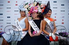Myer Fashions on the Field Women's Racewear winner Emily Hunter (C) poses with first runner up Charlotte Moor (R) and second runner up Jyselle Des-Forges (L). Photo: Getty