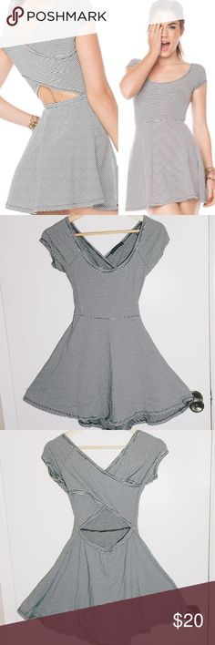 Brandy Melville Bethan Dress Black and white pinstripe brandy Melville Bethan dress. Great condition! Only worn once. One size. Soft, comfortable fabric, great fit! Brandy Melville Dresses Mini