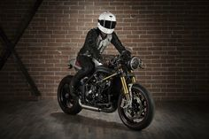 "Awesome Speed Triple 2011 Cafe Racer, made by ""Slaves of Speed"". Arguably the most impresive and refined ST Cafe out there. Great job guys."