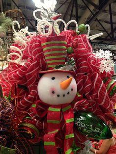 Snowman wreath. Avail at ambermarieandcompany.com.