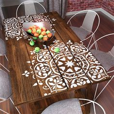 Here's a popular trend for adding a stencilled design onto a dining table. It's a great way to add flair to a reclaimed wood dining table.