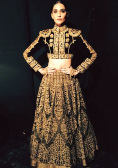 Beautiful golden works on a black lehenga! Designed by Shantanu and Nikhil #Designer #BridalOutfits