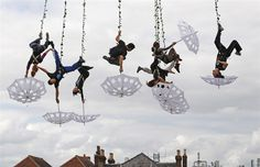 Aerial dancers rehearse for Salisbury International Arts Festival - white umbrellas!