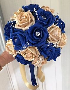 Bridesmaids Posy Bouquet Royal Blue and Gold roses with pearl loops<br> Bridesmaids Posy Bouquet, Royal Blue and Gold roses with pearl loops Gold Bouquet, Royal Blue Bouquet, Royal Blue Flowers, Royal Blue And Gold, Royal Blue Dresses, Blue And Gold Dress, Bouquets, Blue Roses, Fresh Flowers