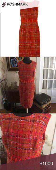 Carolina Herrera New York wool blend dress Crafted from bold signal-orange tweed, Carolina Herrera's cutout dress will provoke serious style envy. Carolina Herrera dress: multicolored tweed wool blend dress. Carolina Herrera Dresses Midi